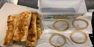Böreklerin içine altın gizledi, polise yakalandı