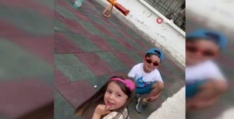 Polis ekiplerinden saklanan küçük çocuklar kameralara yakalandı