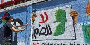 Filistinli gençler, İsrail'in ilhakını grafiti çizerek protesto etti