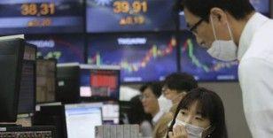 Asya borsaları: Endeksler Fed'in ekonomik teşviklerin süreceğine işaret etmesiyle karışık seyretti