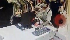Cep telefonu çalan kadın hırsız kamerada