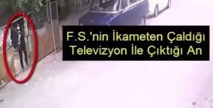 Televizyonu kucağına alıp kaçan hırsız yakalandı