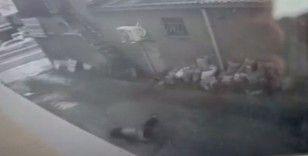 Genç kızın çalıştığı iş yerinin camından düştüğü anlar kamerada