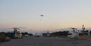 Hava araçları yangınları söndürmek için sabahın ilk ışıklarıyla havalanıp gün batımında piste dönüyor